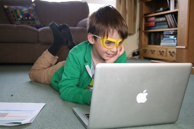 Child playing on a laptop